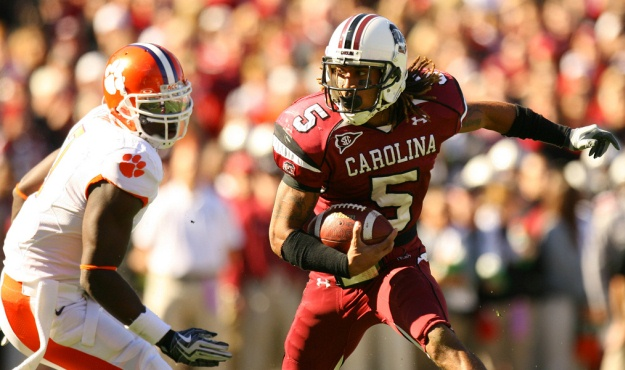 South Carolina's Stephon Gilmore gets around Clemson's Ricky Sapp  during first-quarter action in Columbia, S.C. on Saturday, Nov. 28, 2009. The play was a part of a drive that led to a Gamecock touchdown. (Travis Bell/Sideline Carolina)