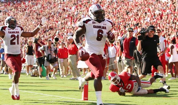 South Carolina's Melvin Ingram scores a touchdown as Georgia's Cory Campbell falls down during second-quarter action in Athens, Ga. on Saturday, Sept. 10, 2011. At left is DeVonte Holloman. (Photo by Travis Bell/Sideline Carolina)