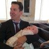 Thomas Ravenel holds his daughter, Kensington Calhoun Ravenel, following her Christening ceremony.